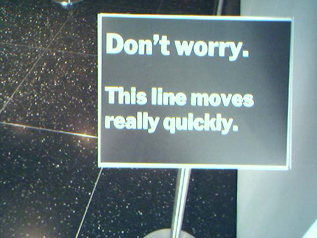 Street sign that says: Don't worry. This line moves really quickly