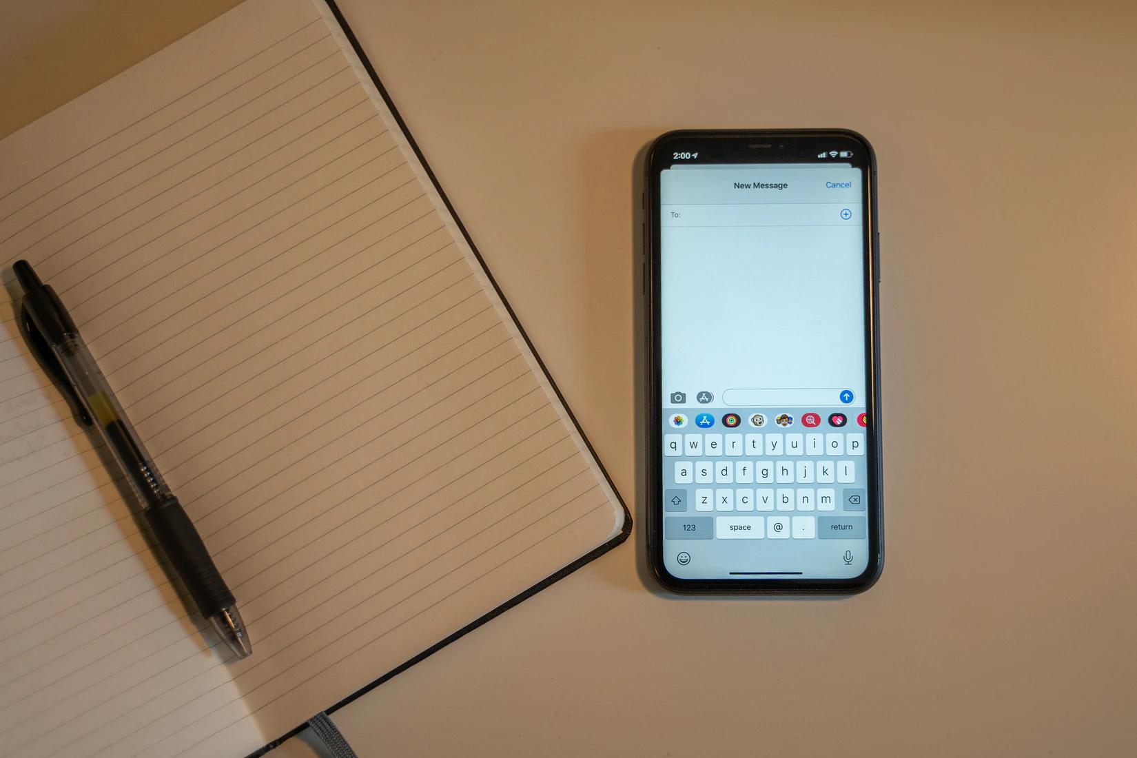 Phone and notebook - Oscar Mucyo Unsplash