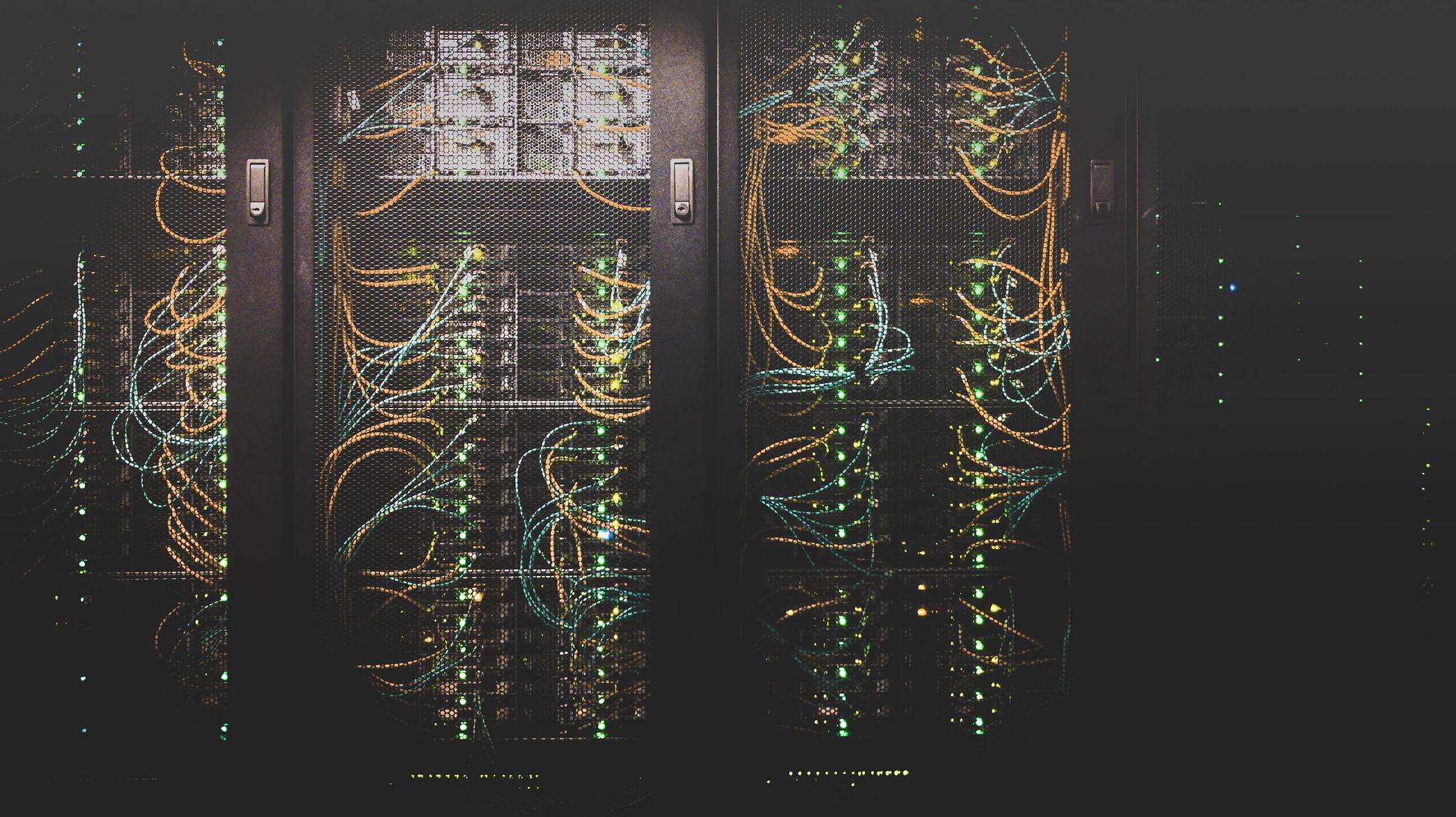 Image of server racks by Taylor Vick (Unsplash @tvick)