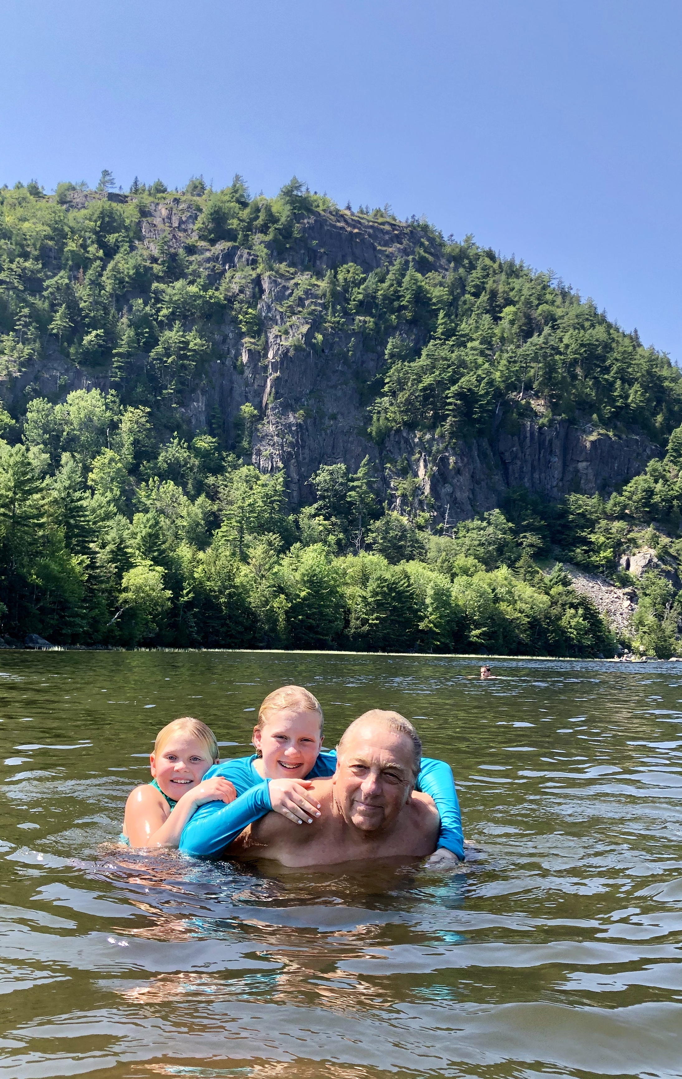 Audrey and Lorelei in Echo lake with Gramps