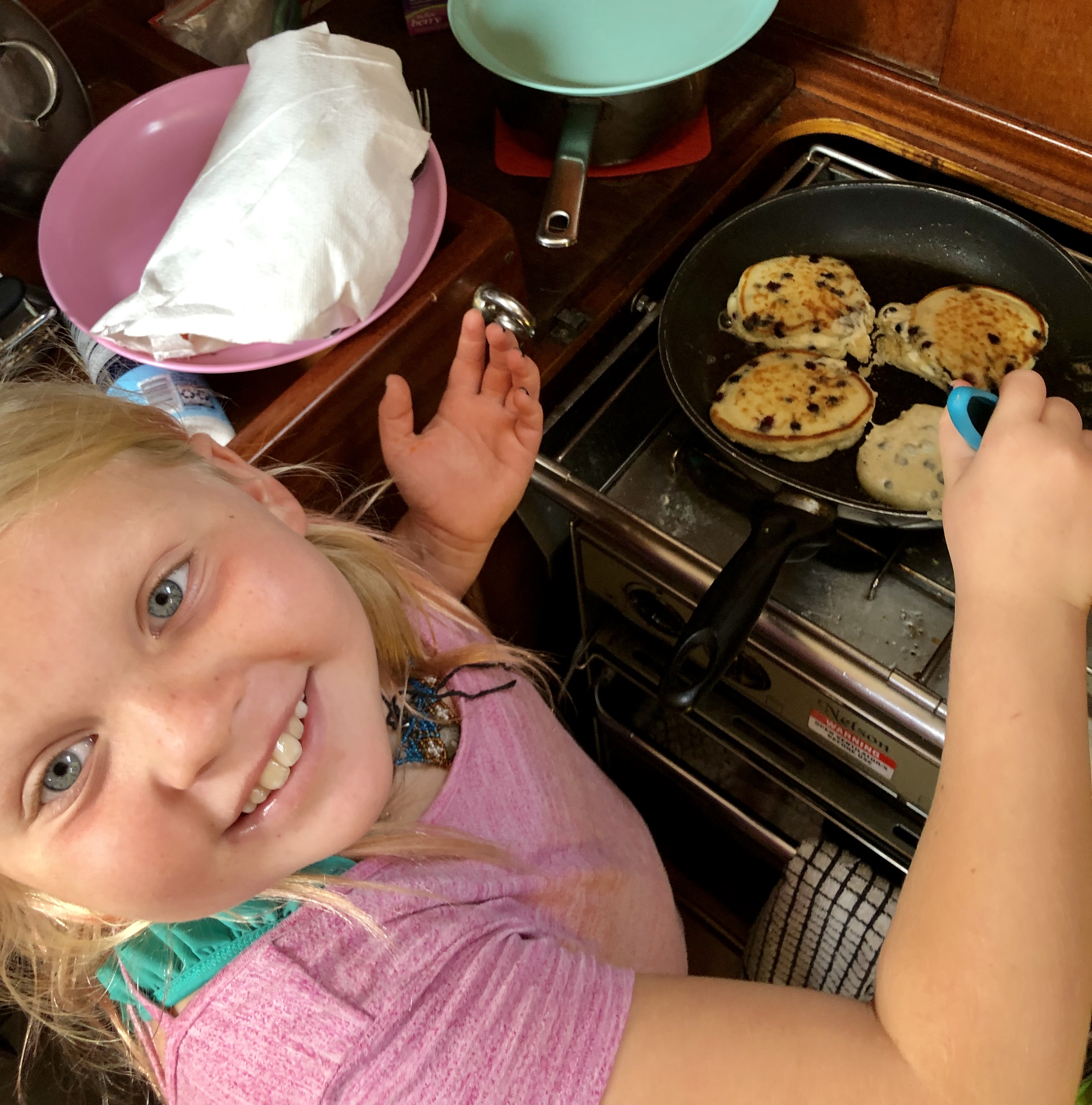 Lorelei making blueberry pancakes