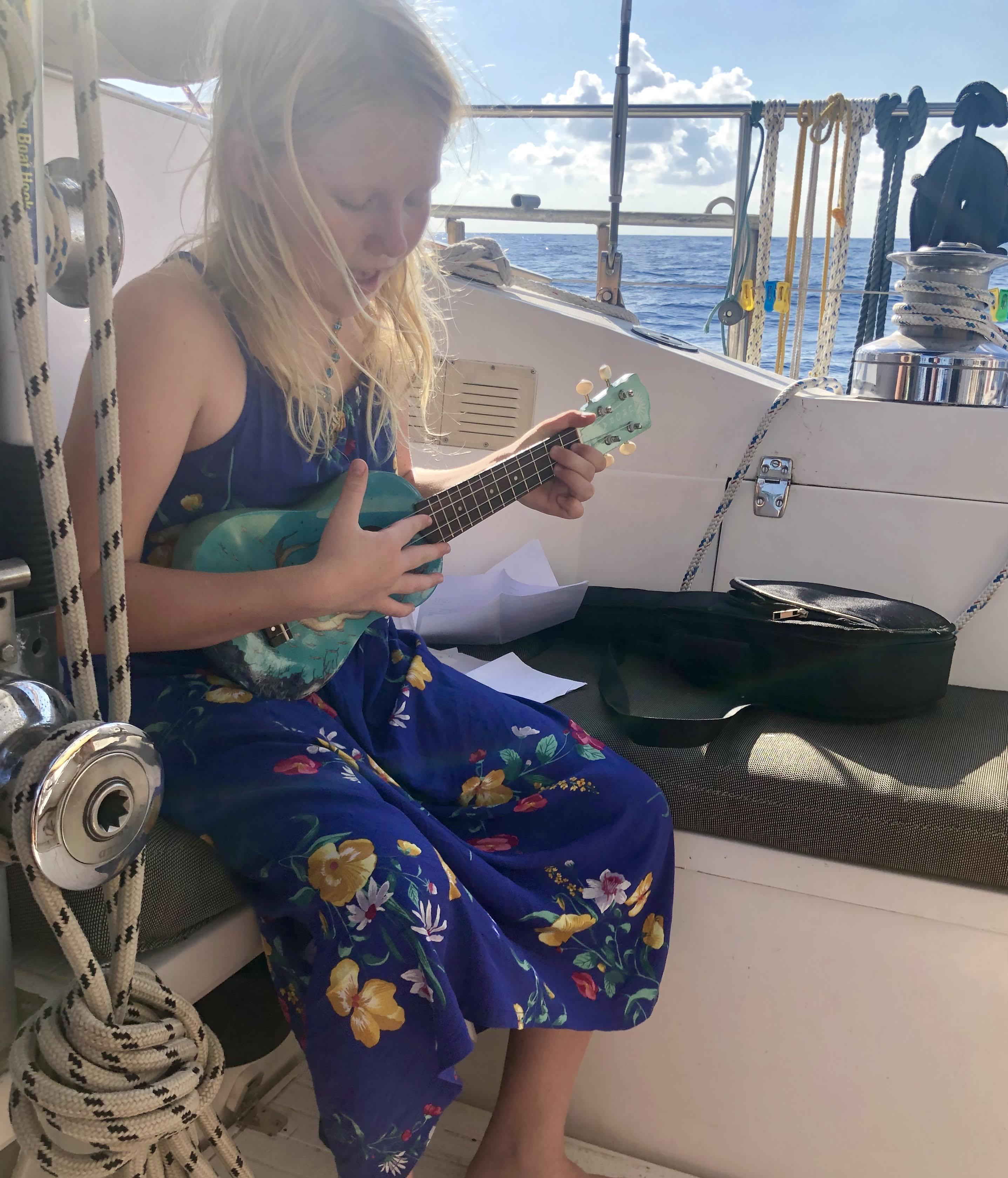 Audrey playing Ukulele on passage
