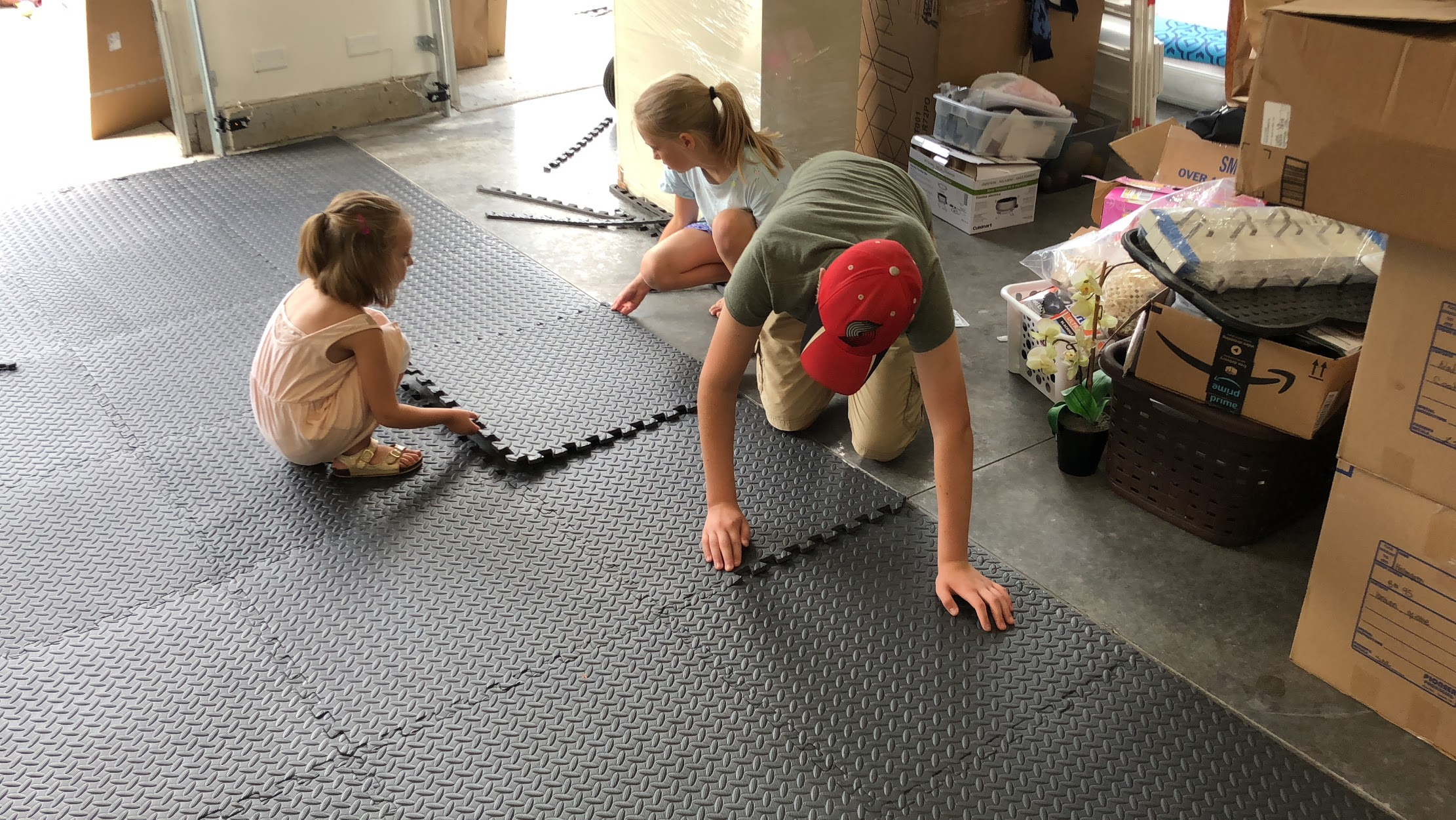 My kids putting in the rubber mats