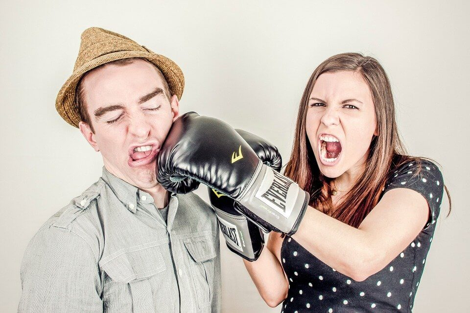 Image of woman slugging a man - Simplified Pixabay License