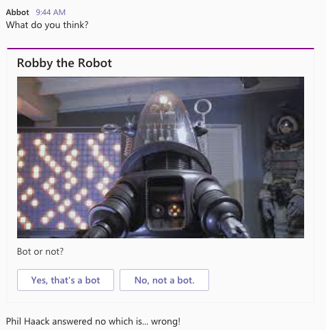 Image of Robby the Robot with two button choices. Is the subject a bot or not? Phil chose the wrong answer. Sad trombone.