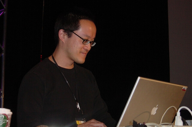 John Lam preparing for a talk
