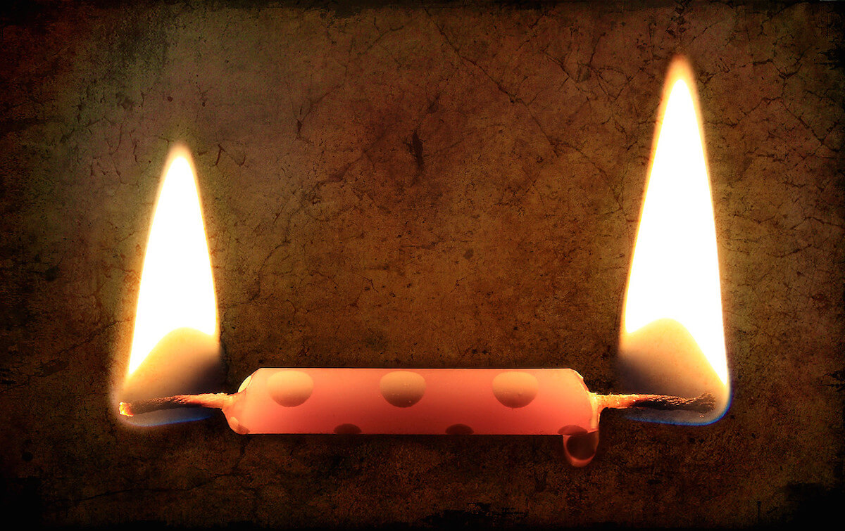 Image of candle burning from both ends