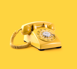 Lovely old school yellow telephone.