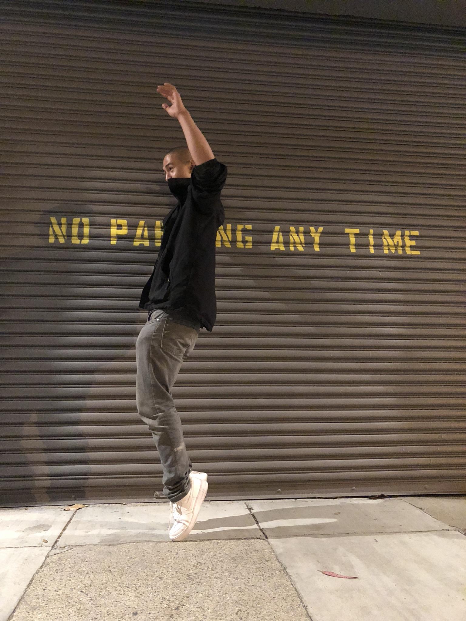 energetic dance toe freeze on nite sidewalk